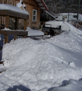 Snow mounds in front of the house
