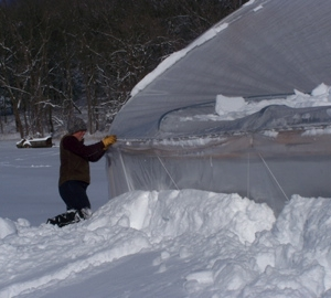The snow is about 4\' deep along each of the side walls