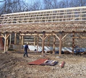 Front view of the barn with the rafters