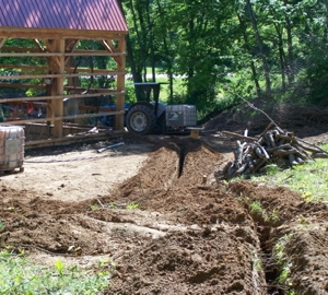 Digging the trenches to the barn for the water & electric lines