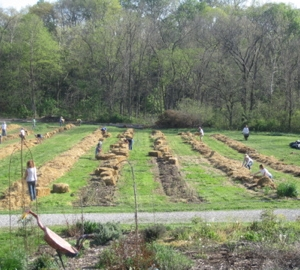 Spreading mulch with the Earth Dance