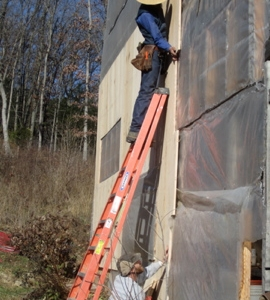 Nailing up the siding boards