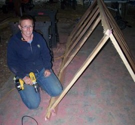 Liz puts in screws at the base of the trusses