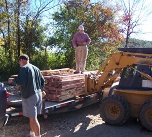 Unloading the freshly sawn lumber for the side and end walls