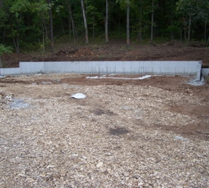 Concrete wall & pad are in for the barn