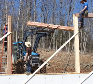 JT sets a beam in place with his tractor