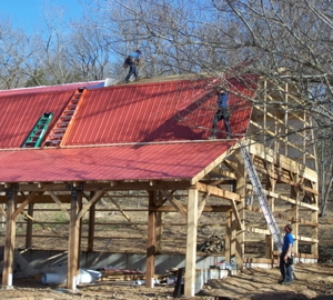 Putting on the metal roof