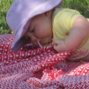 May 1st playing outside on a blanket