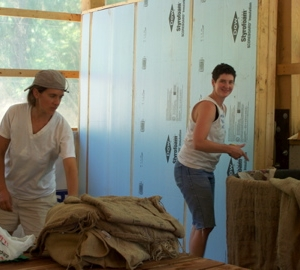 Kristen (a friend visiting from NY with her family) & Katie working on the walls of the cooler