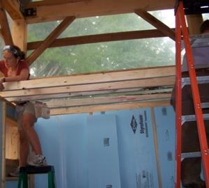 Kristen & Liz attach the rafters for the ceiling