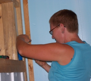 Liz installing the electrical outlet